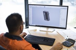 Anthony Chiera uses Solidworks CAD software to design a component for fabrication.